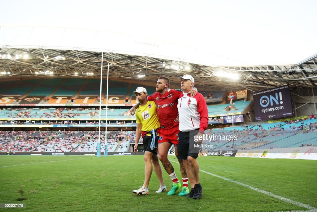 Josh Dugan of the Dragons is assisted from the field after sustaining an injury during the round five NRL match between the Wests Tigers and the St George Illawarra Dragons at ANZ Stadium on April 2, 2017 in Sydney, Australia.