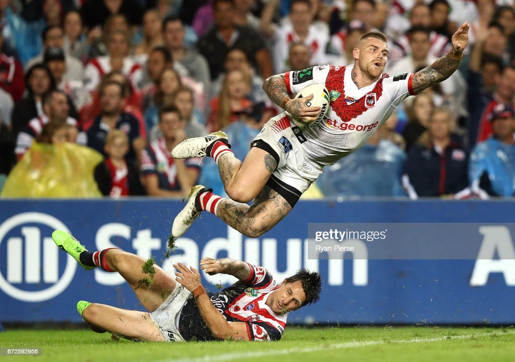 Josh Dugan of the Dragons is tackled by Mitchell Pearce of the Roosters in the in-goal area during the round eight NRL match between the Sydney Roosters and the St George Illawarra Dragons at Allianz Stadium on April 25, 2017 in Sydney, Australia.