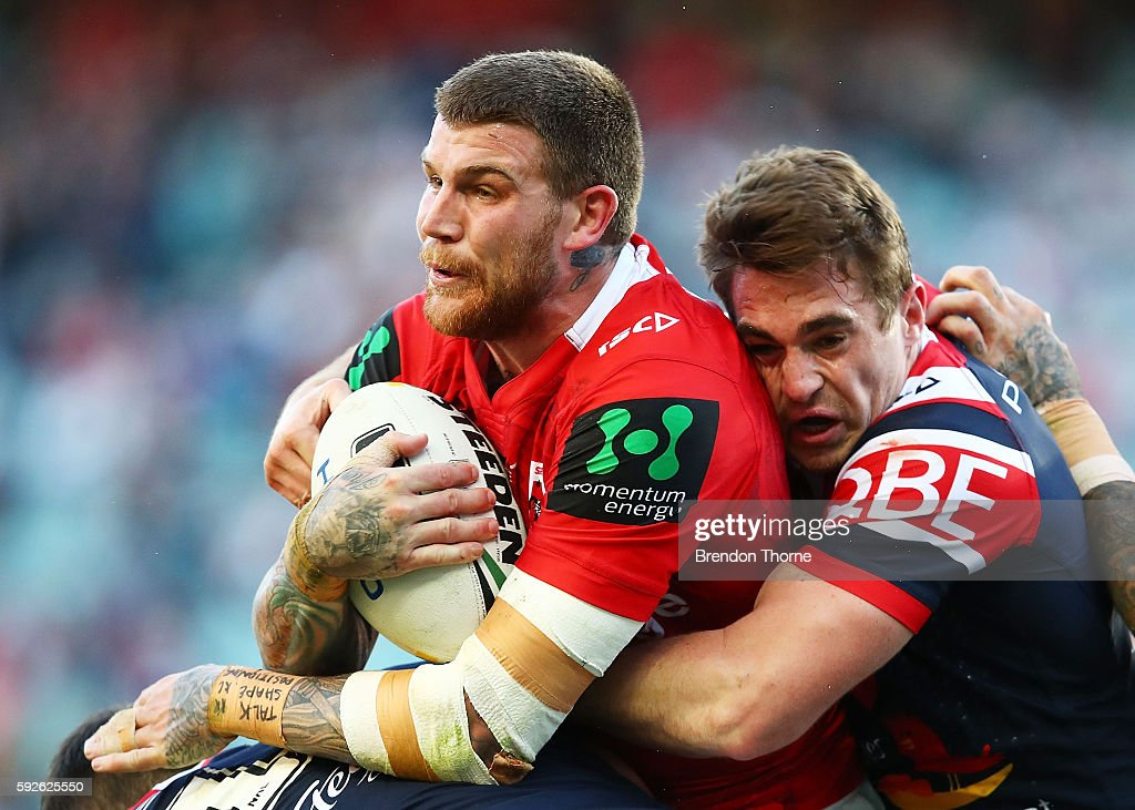 Josh Dugan of the Dragons is tackled by Roosters defence during the round 24 NRL match between the Sydney Roosters and the St George Illawarra Dragons at Allianz Stadium on August 21, 2016 in Sydney, Australia.