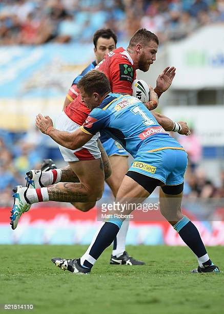 Josh Dugan of the Dragons is tackled by William Zillman of the Titans during the round seven NRL match between the Gold Coast Titans and the St...