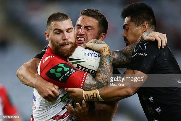 Josh Dugan of the Dragons is tackled during the round 11 NRL match between the South Sydney Rabbitohs and the St George Illawarra Dragons at ANZ...