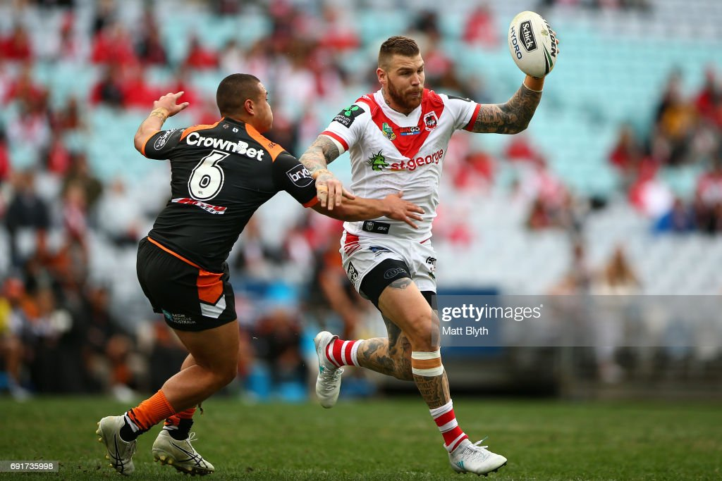 Josh Dugan of the Dragons is tackled during the round 13 NRL match between the St George Illawarra Dragons and the Wests Tigers at ANZ Stadium on June 3, 2017 in Sydney, Australia.