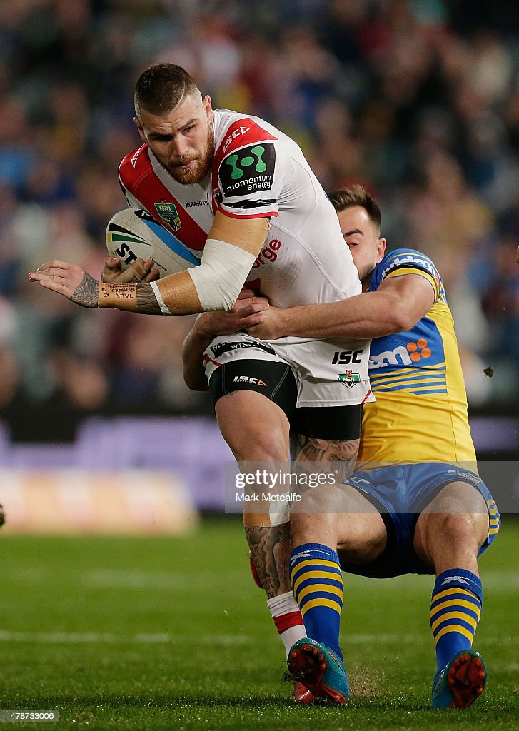 Josh Dugan of the Dragons is tackled during the round 16 NRL match between the Parramatta Eels and the St George Illawarra Dragons at Pirtek Stadium...