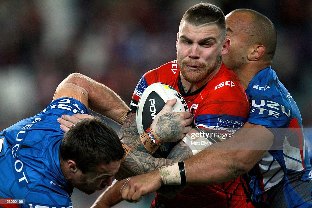 Josh Dugan of the Dragons is tackled during the round 21 NRL match between the Sydney Roosters and the St George Illawarra Dragons at Allianz Stadium on August 2, 2014 in Sydney, Australia.