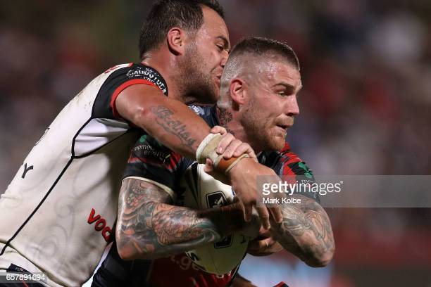 Josh Dugan of the Dragons is tackled during the round four NRL match between the St George Illawarra Dragons and the New Zealand Warriors at UOW...
