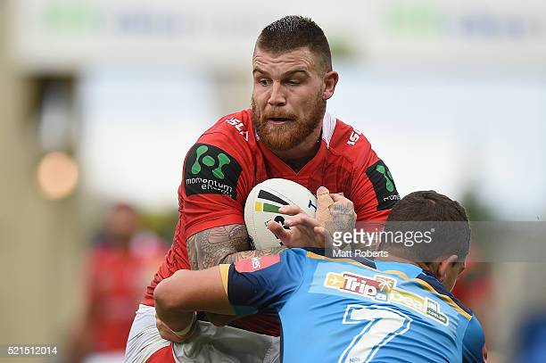Josh Dugan of the Dragons is tackled during the round seven NRL match between the Gold Coast Titans and the St George Illawarra Dragons at Cbus Super...