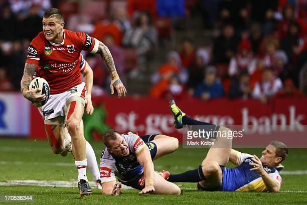 Josh Dugan of the Dragons makes a break during the round 14 NRL match between the St George Illawarra Dragons and the North Queensland Cowboys at WIN...