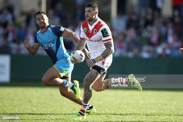Josh Dugan of the Dragons runs the ball during the round 23 NRL match between the St George Illawarra Dragons and the Gold Coast Titans at UOW...