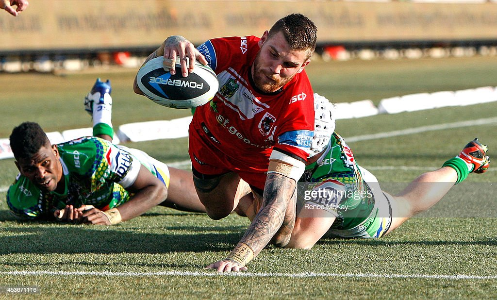 Josh Dugan of the Dragons scores a try during the round 23 NRL match between the Canberra Raiders and the St George Illawarra Dragons at GIO Stadium...