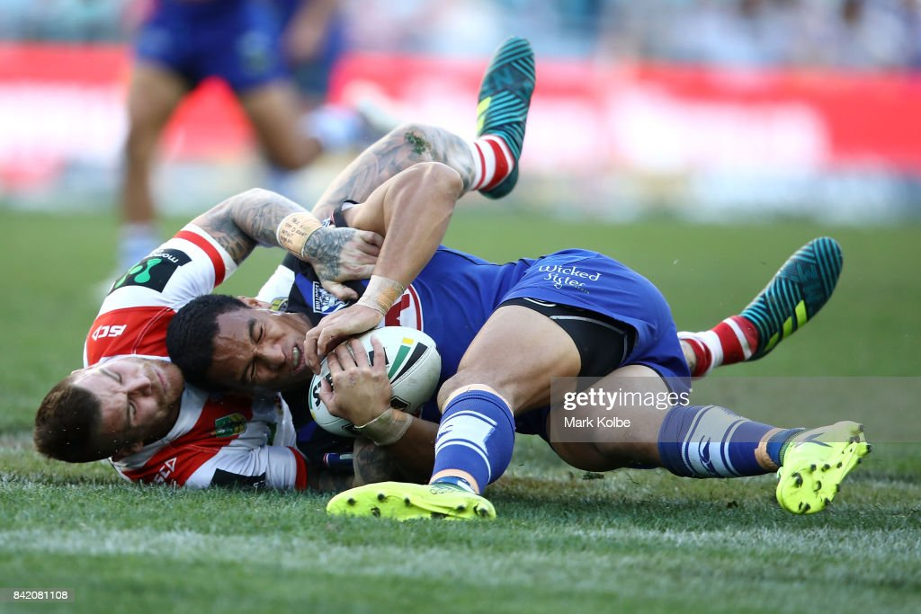 Josh Dugan of the Dragons tackles Will Hopoate of the Bulldogs during the round 26 NRL match between the St George Illawarra Dragons and the Canterbury Bulldogs at ANZ Stadium on September 3, 2017 in Sydney, Australia.