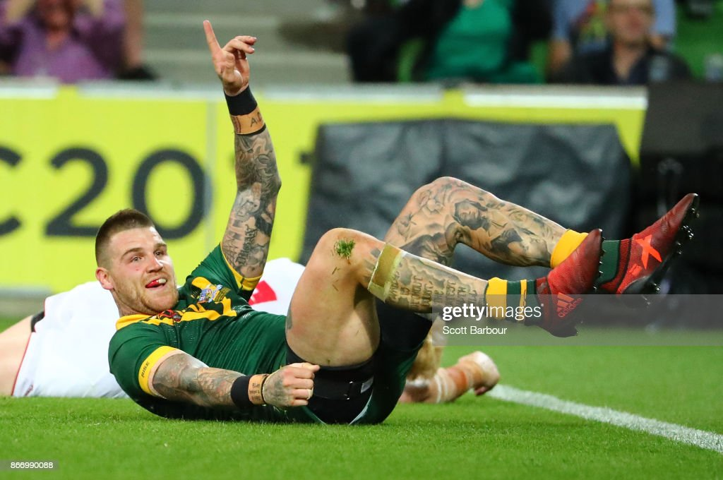 Josh Dugan of the Kangaroos celebrates after scoring a try during the 2017 Rugby League World Cup match between the Australian Kangaroos and England at AAMI Park on October 27, 2017 in Melbourne, Australia.