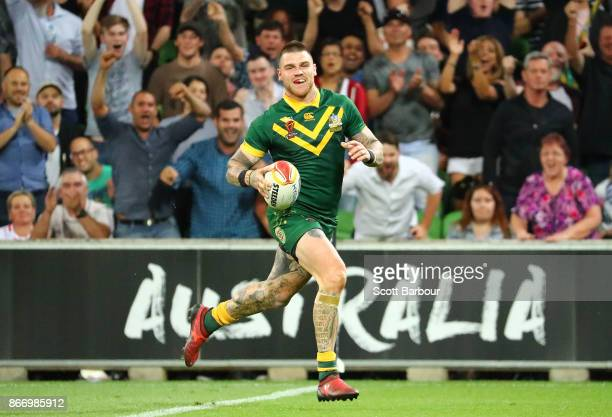 Josh Dugan of the Kangaroos runs in to score a try during the 2017 Rugby League World Cup match between the Australian Kangaroos and England at AAMI...