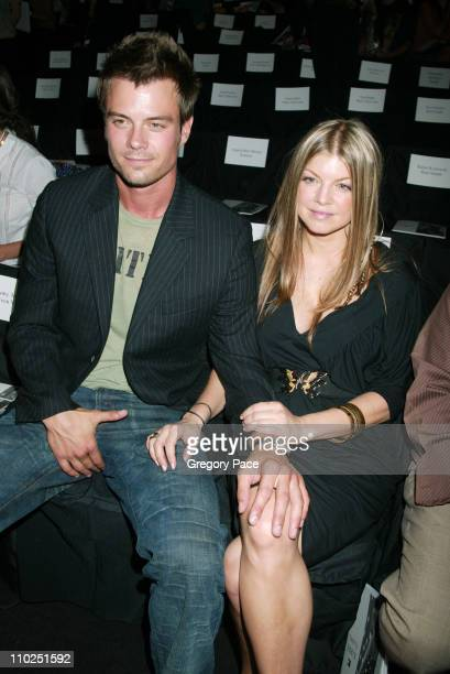 Josh Duhamel and Fergie of Black Eyed Peas during Olympus Fashion Week Spring 2006 Tommy Hilfiger Front Row and Backstage at Bryant Park in New York...