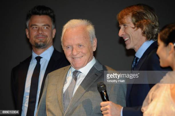 Josh Duhamel Sir Anthony Hopkins Michael Bay and Isabela Moner speak onstage at the US premiere of 'Transformers The Last Knight' at the Civic Opera...