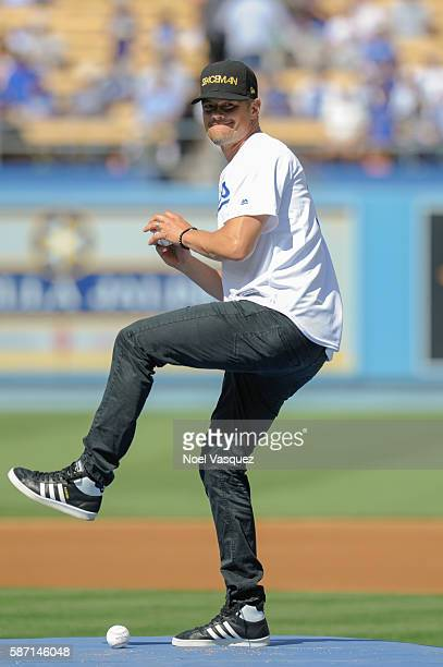 Josh Duhamel throws the ceremonial first pitch before a game between the Boston Red Sox and the Los Angeles Dodgers at Dodger Stadium on August 7...