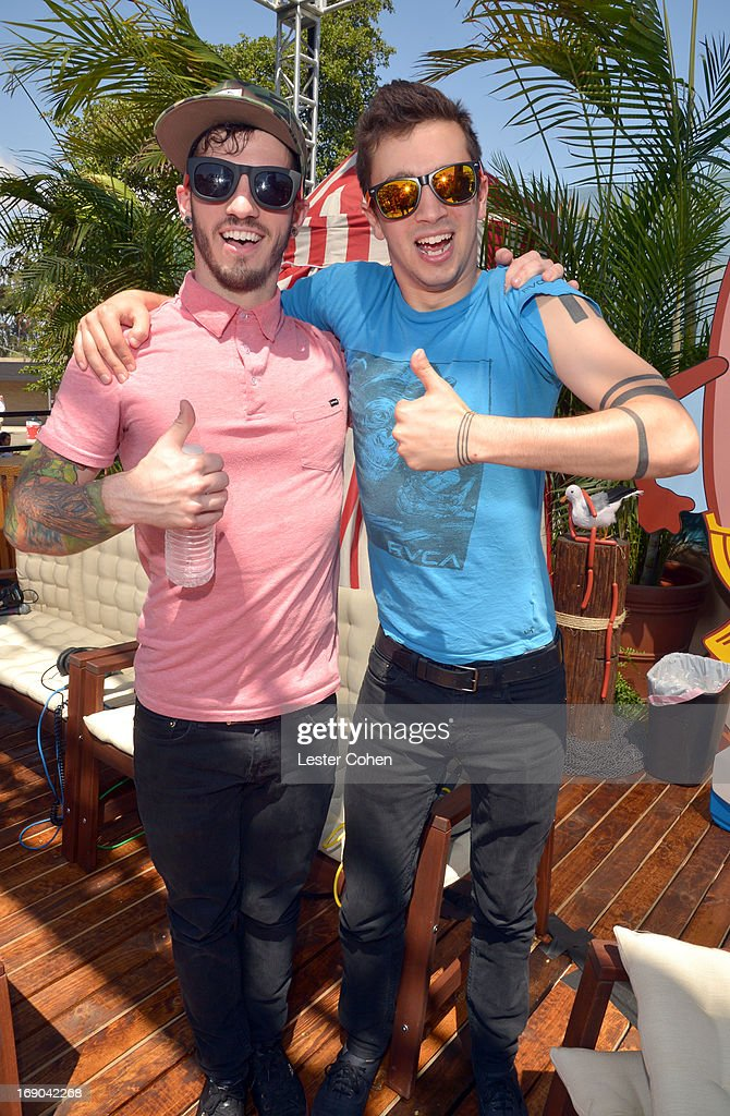 Josh Dun and Tyler Joseph of 21 Pilots backstage during KROQ Weenie Roast Y Fiesta at Verizon Wireless Amphitheater on May 18, 2013 in Irvine, California.
