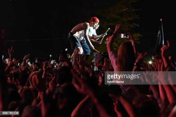 Josh Dun and Tyler Joseph of Twenty One Pilots performs in the crowd during the 2017 Firefly Music Festival on June 16 2017 in Dover Delaware