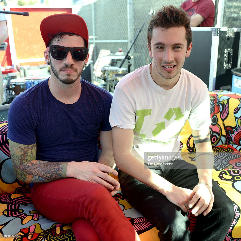 Josh Dun (L) and Tyler Joseph of Twenty One Pilots pose at Waterloo Records on March 13, 2013 in Austin, Texas.