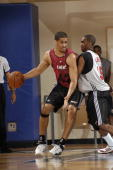 Josh Duncan of the Miami Heat post up against Cedric Simmons of the Chicago Bulls during the 2008 Orlando Pro Summer League at the RDV Sportsplex on...