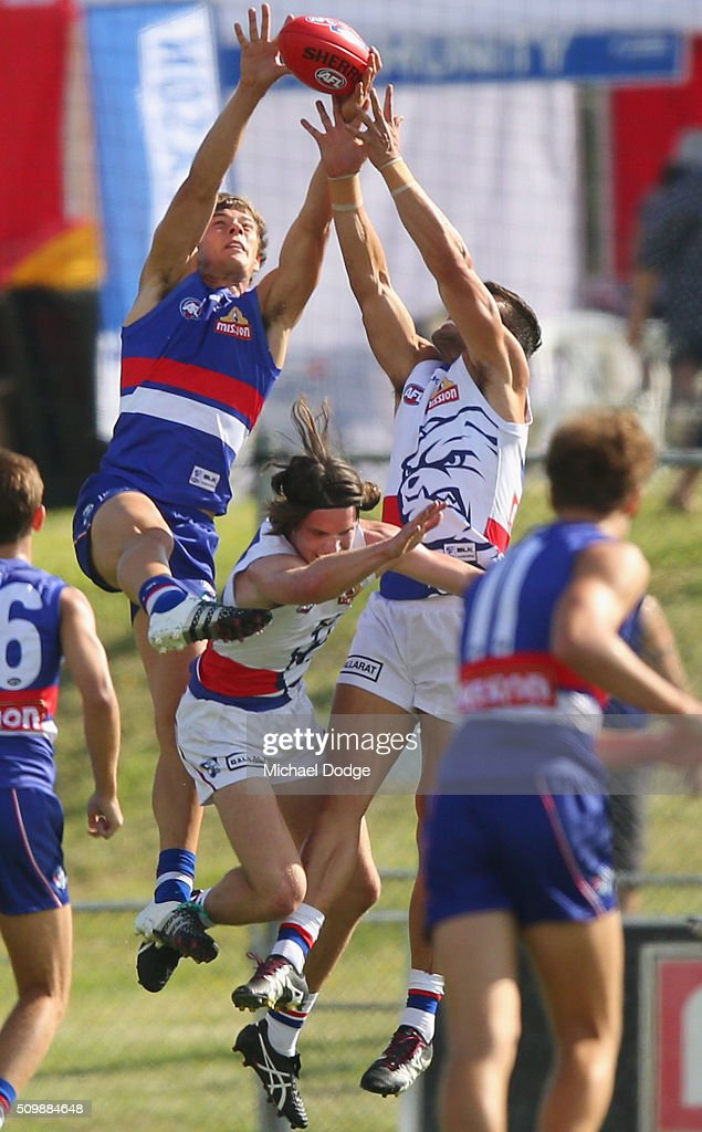 Josh Dunkley (L) competes for the ball during the Western Bulldogs AFL intra-club match at Whitten Oval on February 13, 2016 in Melbourne, Australia.