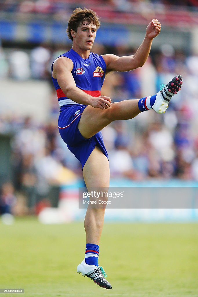 Josh Dunkley kicks the ball during the Western Bulldogs AFL intra-club match at Whitten Oval on February 13, 2016 in Melbourne, Australia.