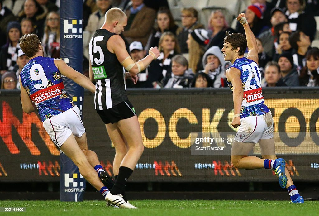 Josh Dunkley of the Bulldogs celebrates after kicking a goal during the round 10 AFL match between the Collingwood Magpies and the Western Bulldogs at Melbourne Cricket Ground on May 29, 2016 in Melbourne, Australia.