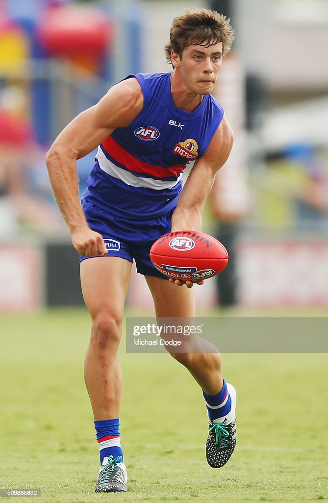 Josh Dunkley of the Bulldogs handballs during the Western Bulldogs AFL intra-club match at Whitten Oval on February 13, 2016 in Melbourne, Australia.