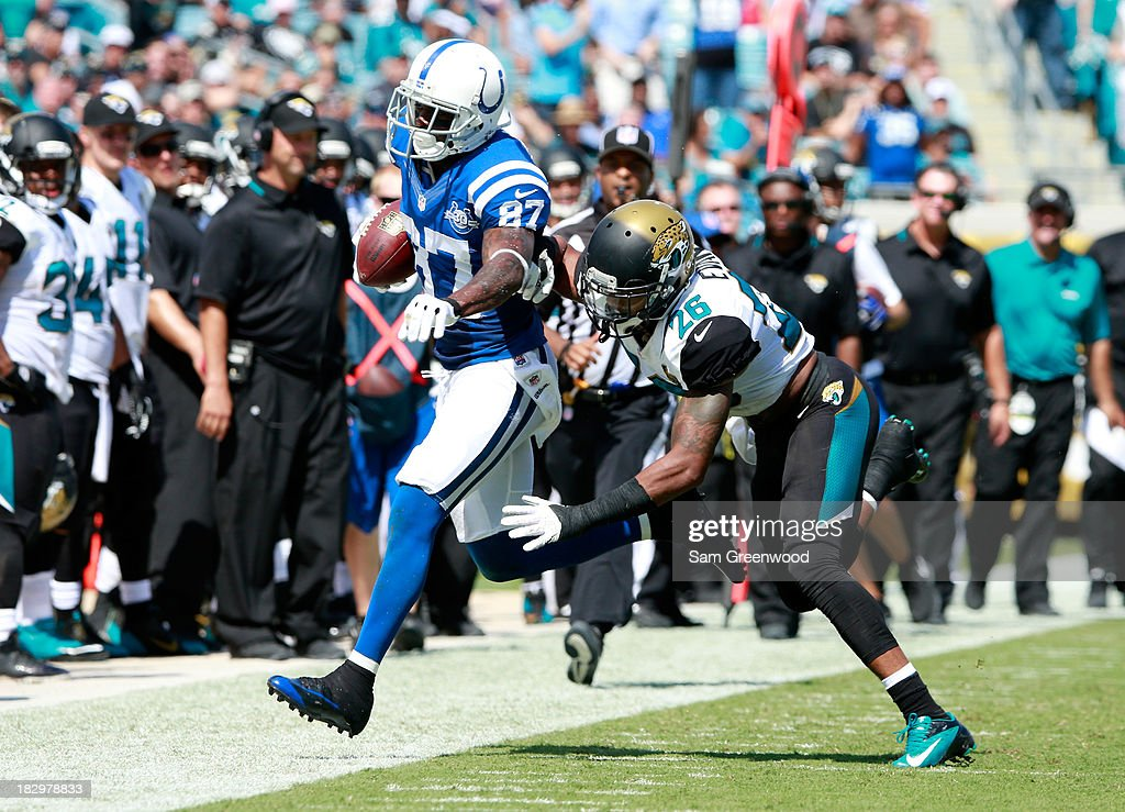 Josh Evans #26 of the Jacksonville Jaguars attempts to tackle Reggie Wayne #87 of the Indianapolis Colts during the game at EverBank Field on September 29, 2013 in Jacksonville, Florida.