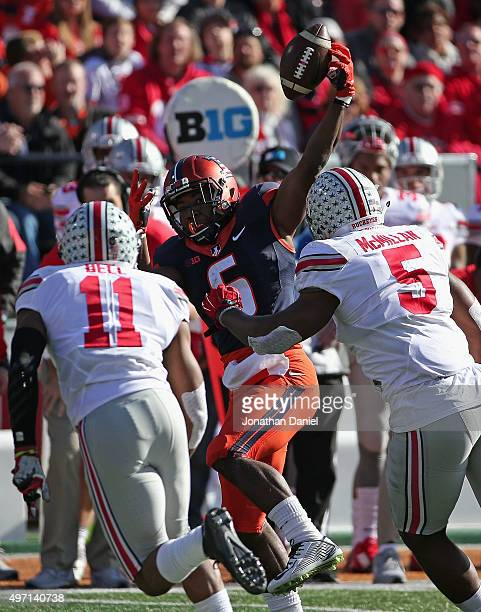 Josh Ferguson of the Illinois Fighting Illini tries to make a catch under pressure from Raekwon McMillan and Vonn Bell of the Ohio State Buckeyes at...