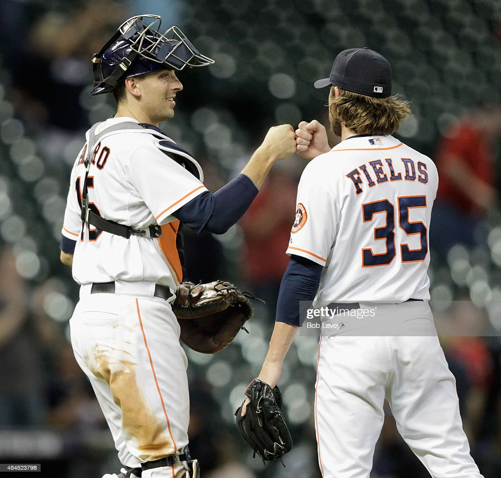 <a gi-track='captionPersonalityLinkClicked' href=/galleries/search?phrase=Josh+Fields&family=editorial&specificpeople=711103 ng-click='$event.stopPropagation()'>Josh Fields</a> #35 of the Houston Astros fist bumps Jason Castro #15 after the final out as the Houston Astros defeated the Los Angeles Angels of Anaheim 8-3 at Minute Maid Park on September 2, 2014 in Houston, Texas.