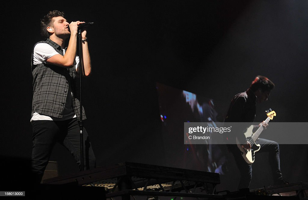 Josh Franceschi and Matt Barnes of You Me At Six perform on stage at Wembley Arena on December 8, 2012 in London, England.