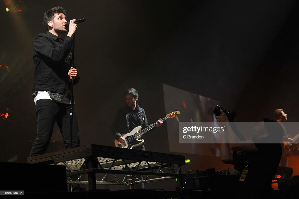 Josh Franceschi, Matt Barnes and Max Helyer of You Me At Six perform on stage at Wembley Arena on December 8, 2012 in London, England.