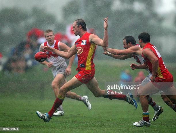 Josh Fraser of the Suns kicks the ball during the NAB Challenge match between the Gold Coast Suns and the Sydney Swans at Southport Oval on March 5...