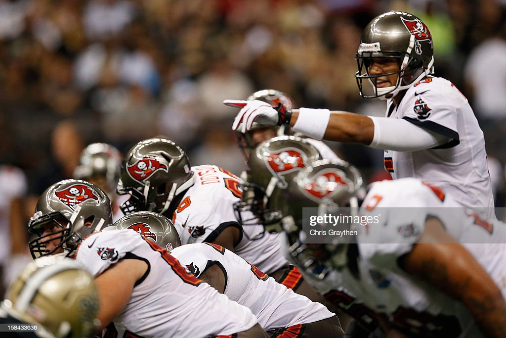 <a gi-track='captionPersonalityLinkClicked' href=/galleries/search?phrase=Josh+Freeman&family=editorial&specificpeople=4036797 ng-click='$event.stopPropagation()'>Josh Freeman</a> #5 of the Tampa Bay Buccaneers calls a play against the New Orleans Saints at the Mercedes-Benz Superdome on December 16, 2012 in New Orleans, Louisiana.