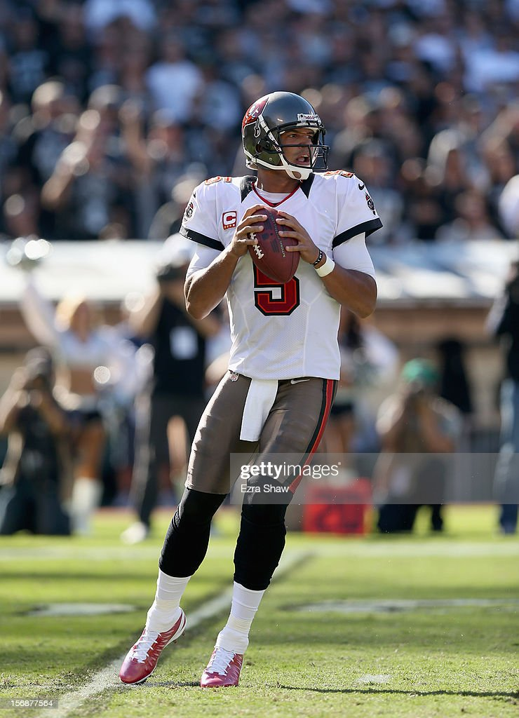 <a gi-track='captionPersonalityLinkClicked' href=/galleries/search?phrase=Josh+Freeman&family=editorial&specificpeople=4036797 ng-click='$event.stopPropagation()'>Josh Freeman</a> #5 of the Tampa Bay Buccaneers in action against the Oakland Raiders at O.co Coliseum on November 4, 2012 in Oakland, California.