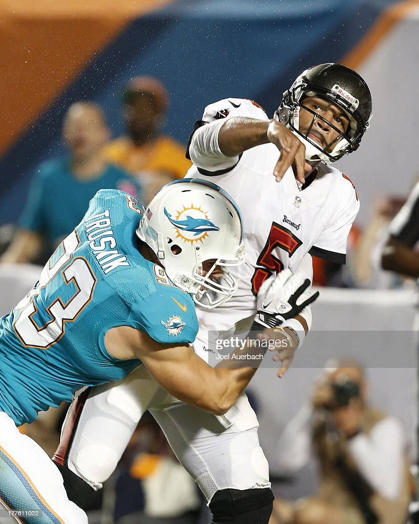 <a gi-track='captionPersonalityLinkClicked' href=/galleries/search?phrase=Josh+Freeman&family=editorial&specificpeople=4036797 ng-click='$event.stopPropagation()'>Josh Freeman</a> #5 of the Tampa Bay Buccaneers is hit by Jason Trusnik #93 of the Miami Dolphins after releasing the ball during a preseason game on August 24, 2013 at Sun Life Stadium in Miami Gardens, Florida. The Buccaneers defeated the Dolphins 17-16.