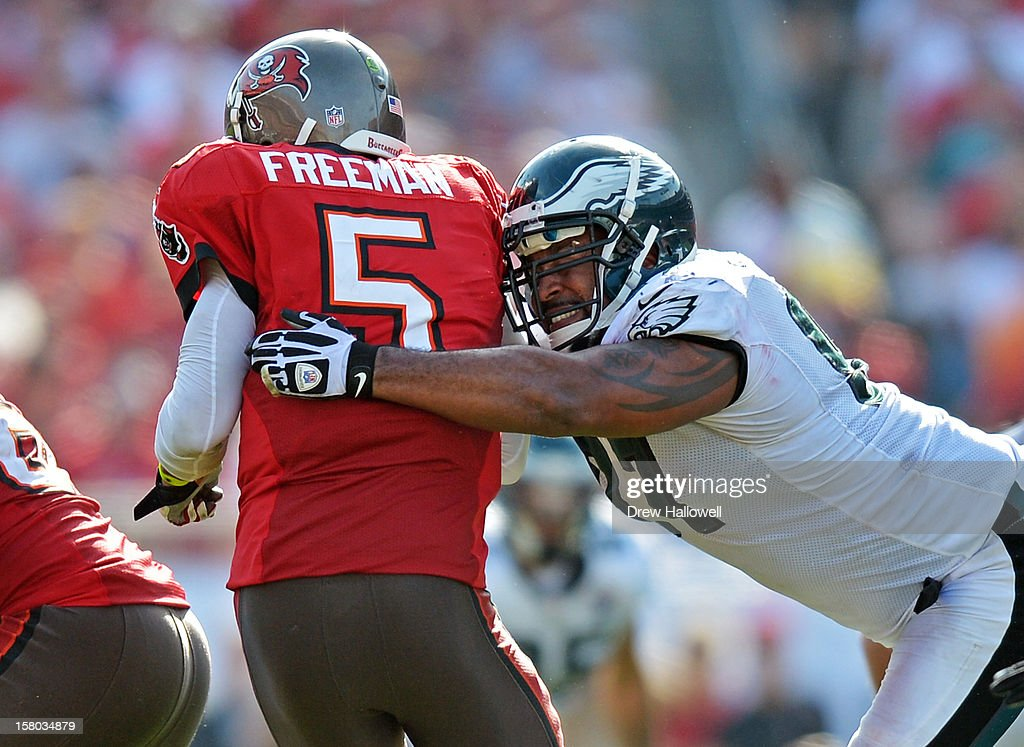 <a gi-track='captionPersonalityLinkClicked' href=/galleries/search?phrase=Josh+Freeman&family=editorial&specificpeople=4036797 ng-click='$event.stopPropagation()'>Josh Freeman</a> #5 of the Tampa Bay Buccaneers is sacked by <a gi-track='captionPersonalityLinkClicked' href=/galleries/search?phrase=Cullen+Jenkins&family=editorial&specificpeople=2096860 ng-click='$event.stopPropagation()'>Cullen Jenkins</a> #97 of the Philadelphia Eagles at Raymond James Stadium on December 9, 2012 in Tampa, Florida. The Eagles won 23-21.