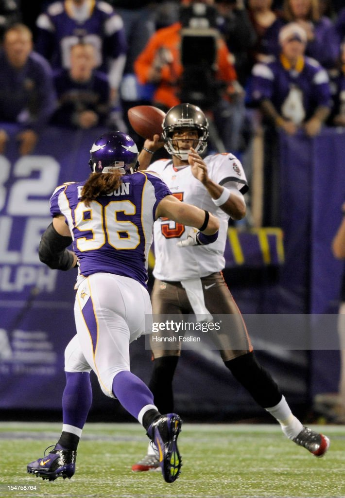 Josh Freeman #5 of the Tampa Bay Buccaneers looks to pass while under pressure from Brian Robison #96 of the Minnesota Vikings during the first quarter of the game on October 25, 2012 at Mall of America Field at the Hubert H. Humphrey Metrodome in Minneapolis, Minnesota.