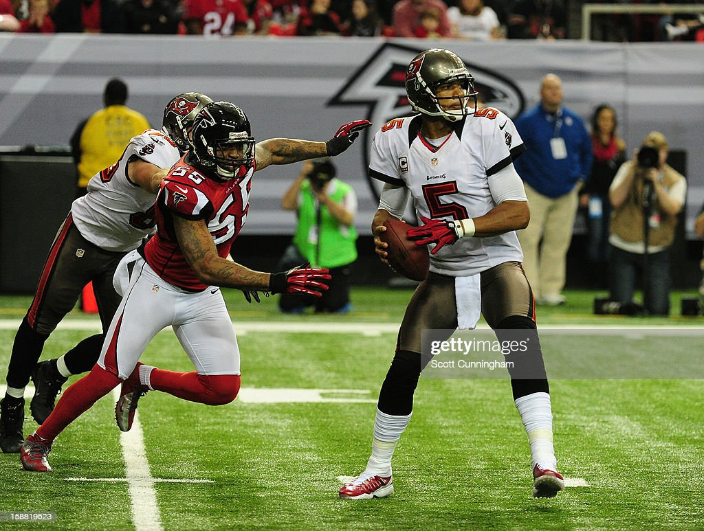 <a gi-track='captionPersonalityLinkClicked' href=/galleries/search?phrase=Josh+Freeman&family=editorial&specificpeople=4036797 ng-click='$event.stopPropagation()'>Josh Freeman</a> #5 of the Tampa Bay Buccaneers passes despite pressure by John Abraham #55 of the Atlanta Falcons at the Georgia Dome on December 30, 2012 in Atlanta, Georgia