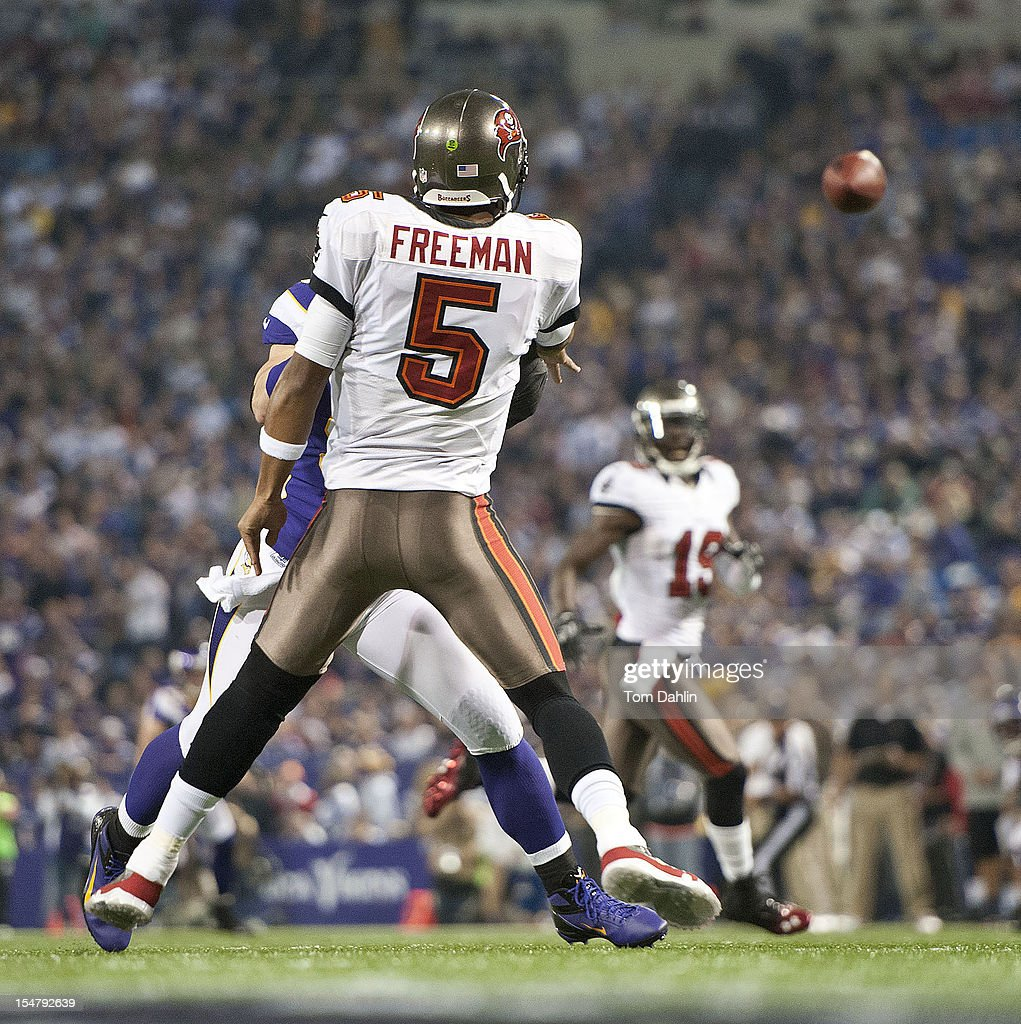 Josh Freeman #5 of the Tampa Bay Buccaneers passes the ball during an NFL game against the Minnesota Vikings at Mall of America Field at the Hubert H. Humphrey Metrodome on October 25, 2012 in Minneapolis, Minnesota.