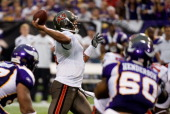 Josh Freeman of the Tampa Bay Buccaneers passes to Arrelious Benn for a touchdown in the fourth quarter against the Minnesota Vikings on September 18...