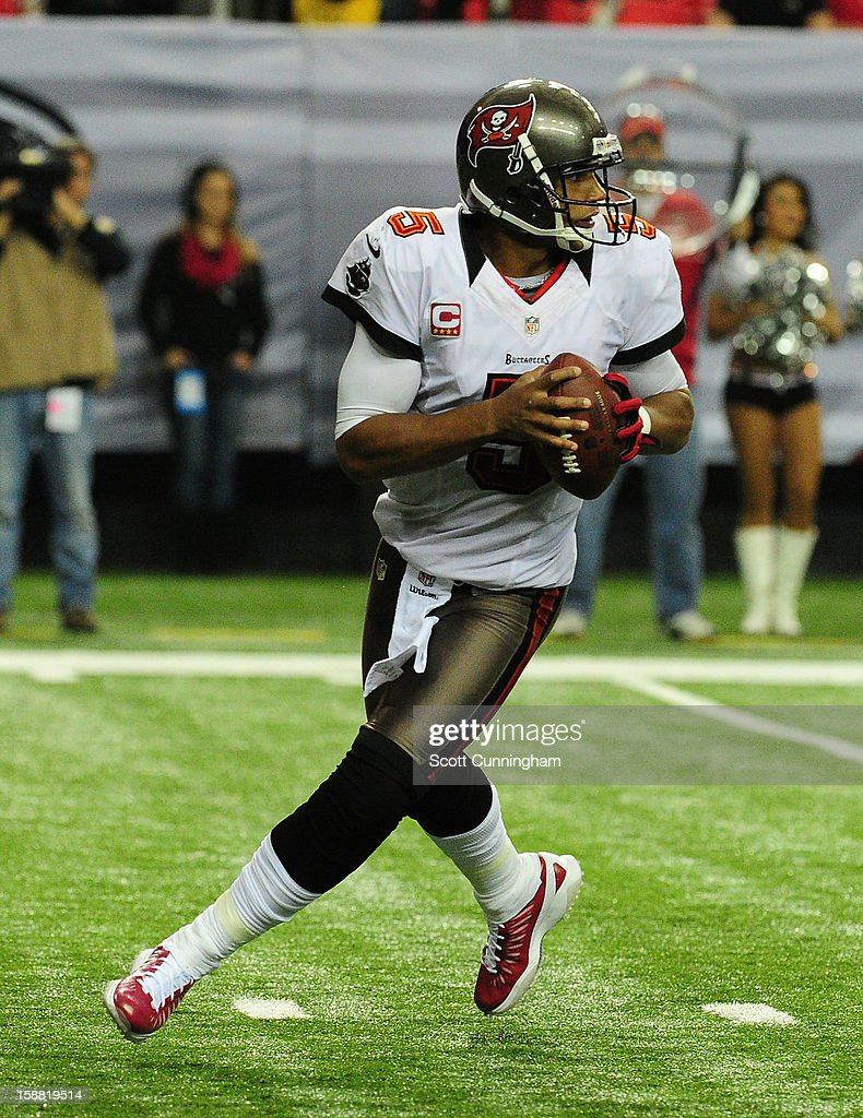 <a gi-track='captionPersonalityLinkClicked' href=/galleries/search?phrase=Josh+Freeman&family=editorial&specificpeople=4036797 ng-click='$event.stopPropagation()'>Josh Freeman</a> #5 of the Tampa Bay Buccaneers rolls out to pass against the Atlanta Falcons at the Georgia Dome on December 30, 2012 in Atlanta, Georgia