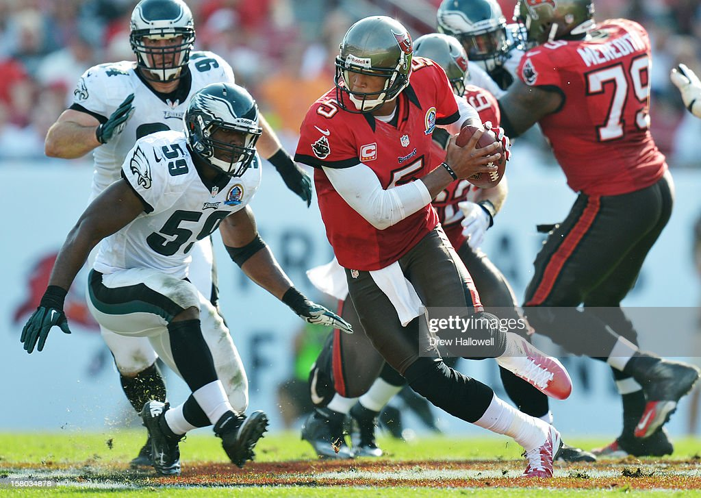 <a gi-track='captionPersonalityLinkClicked' href=/galleries/search?phrase=Josh+Freeman&family=editorial&specificpeople=4036797 ng-click='$event.stopPropagation()'>Josh Freeman</a> #5 of the Tampa Bay Buccaneers scrambles away from DeMeco Ryans #59 of the Philadelphia Eagles at Raymond James Stadium on December 9, 2012 in Tampa, Florida. The Eagles won 23-21.