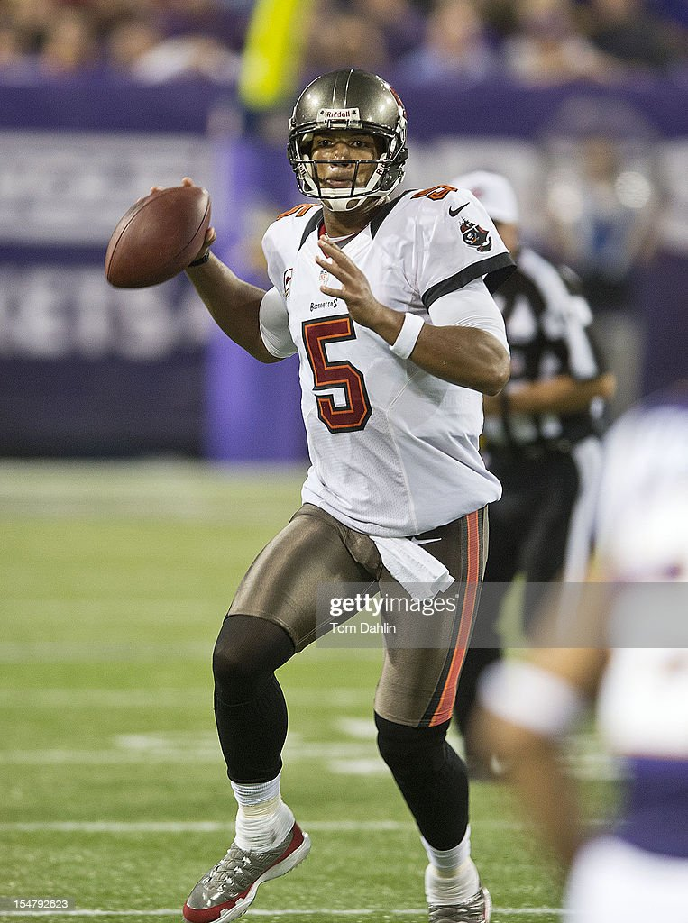 Josh Freeman #5 of the Tampa Bay Buccaneers scrambles during an NFL game against the Minnesota Vikings at Mall of America Field at the Hubert H. Humphrey Metrodome on October 25, 2012 in Minneapolis, Minnesota.