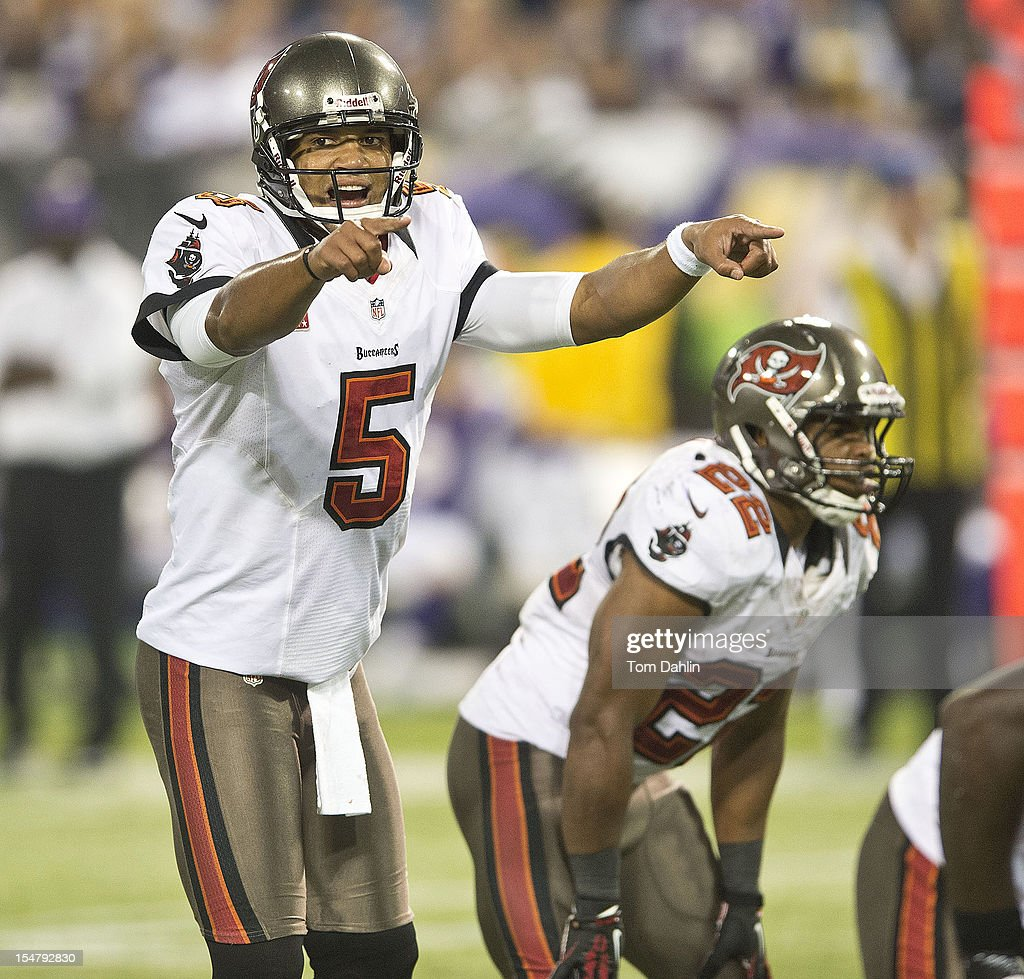 Josh Freeman #5 of the Tampa Bay Buccaneers signals during an NFL game against the Minnesota Vikings at Mall of America Field at the Hubert H. Humphrey Metrodome on October 25, 2012 in Minneapolis, Minnesota.