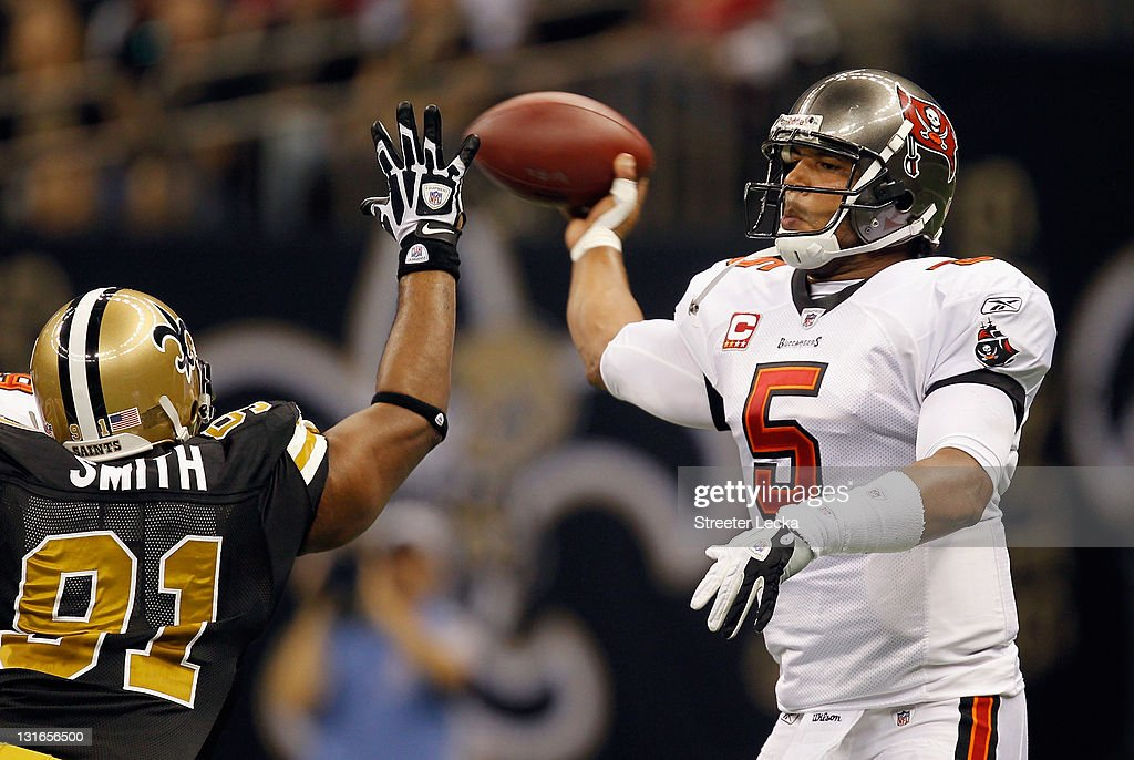 <a gi-track='captionPersonalityLinkClicked' href=/galleries/search?phrase=Josh+Freeman&family=editorial&specificpeople=4036797 ng-click='$event.stopPropagation()'>Josh Freeman</a> #5 of the Tampa Bay Buccaneers tries to throw around Will Smith #91 of the New Orleans Saints during their game at Mercedes-Benz Superdome on November 6, 2011 in New Orleans, Louisiana.