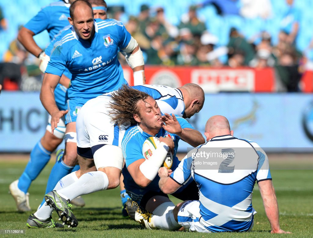 Josh Furno of Italy gets tackled during the Castle Larger Incoming Tour match between Italy and Scotland at Loftus Versfeld on June 22, 2013 in Pretoria, South Africa.