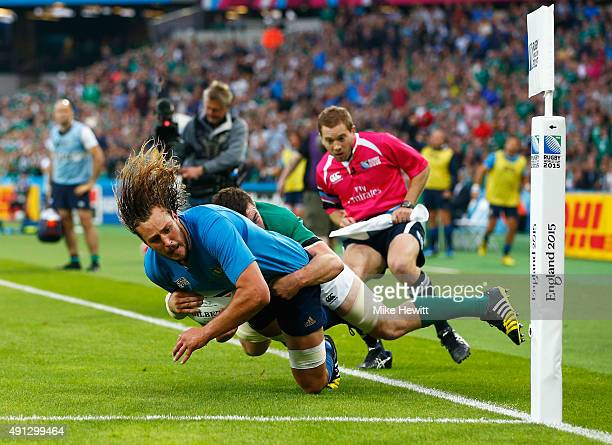 Josh Furno of Italy is tackled by Peter O'Mahony of Ireland to deny a try during the 2015 Rugby World Cup Pool D match between Ireland and Italy at...