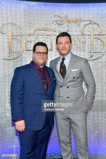 Josh Gad and Luke Evans arrive at the world premiere of Disney's new liveaction 'Beauty and the Beast' photographed in front of the Swarovski crystal...