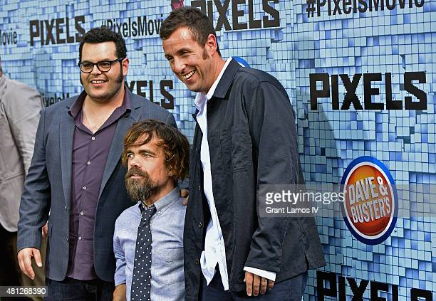 Josh Gad Peter Dinklage and Adam Sandler attend the 'Pixels' New York Premiere at Regal EWalk on July 18 2015 in New York City